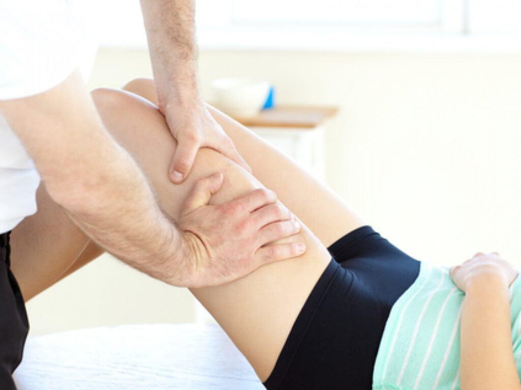 Photo of someone getting their leg massaged.